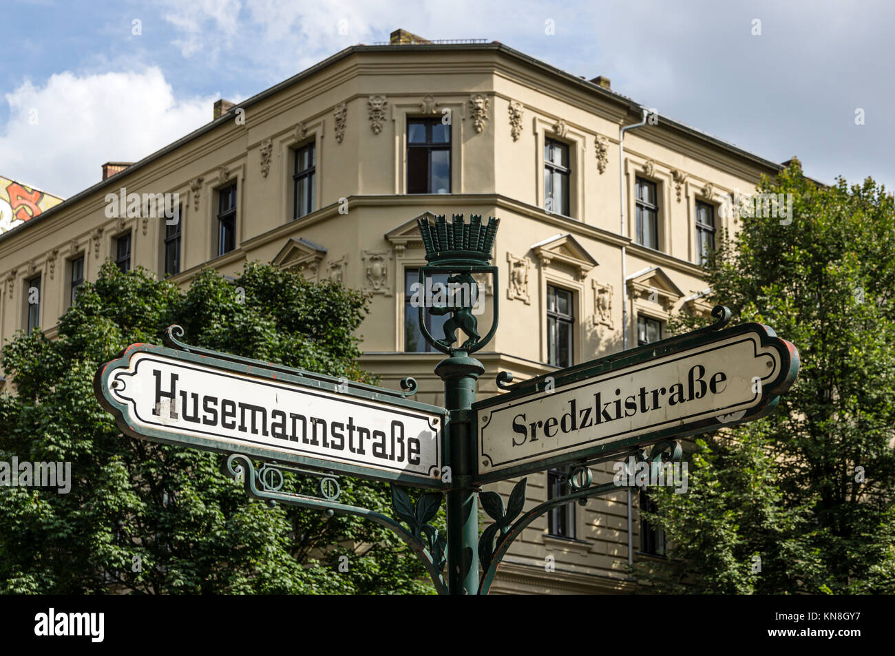 Street sign on the corner of Husemann Straße in East Berlin's Mitte district - Stock Image
