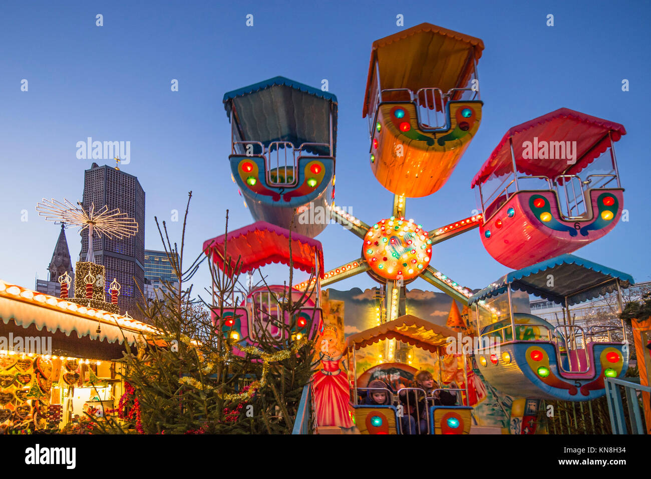 Christmas Market at Kaiser Wilhelm Memorial Church, Breitscheidplatz, Berlin, Germany - Stock Image
