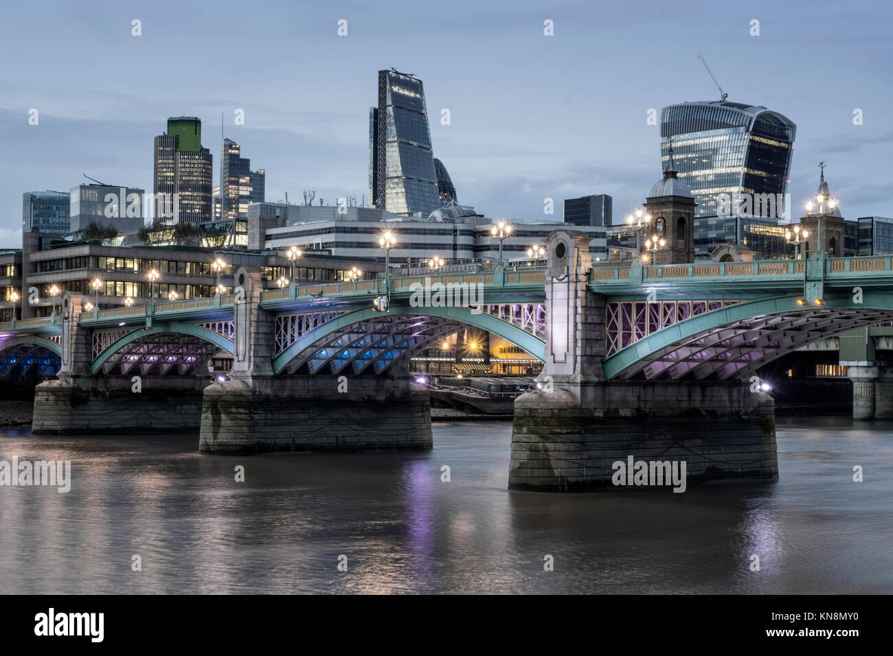 City of London. Financial district office buildings in the City of London, Southwalk Bridge, River Thames at Twilight - Stock Image