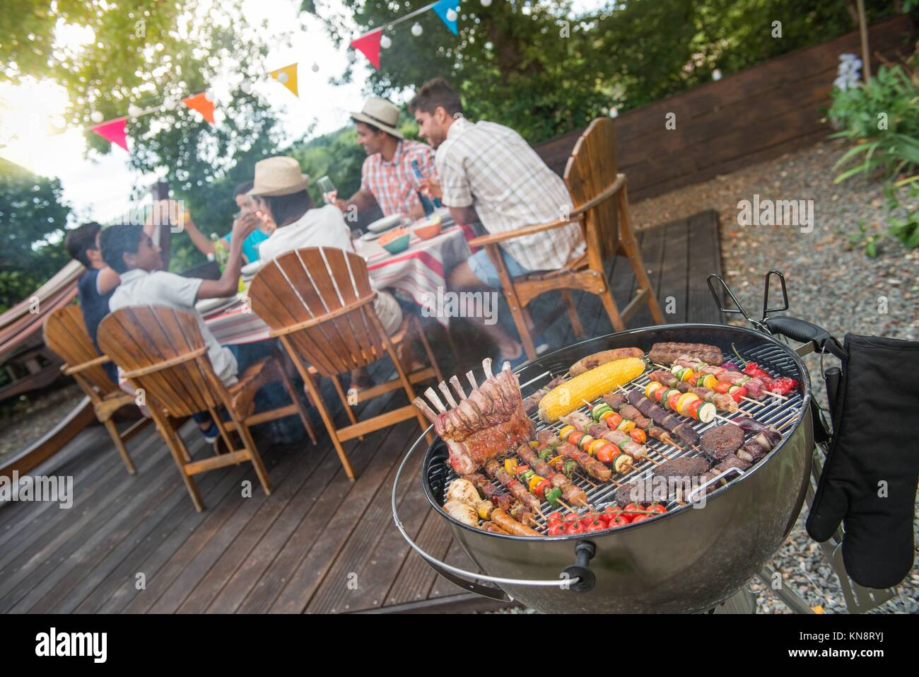 summer garden party grill barbecue stock photos summer garden party grill barbecue stock. Black Bedroom Furniture Sets. Home Design Ideas