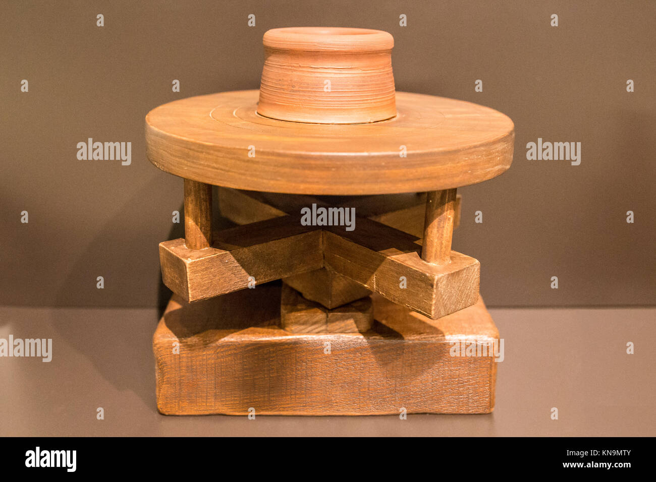 Reconstruction of primitive potter wheel. Brought by Phoenician people to Iberian Peninsula during 9th Century BC - Stock Image