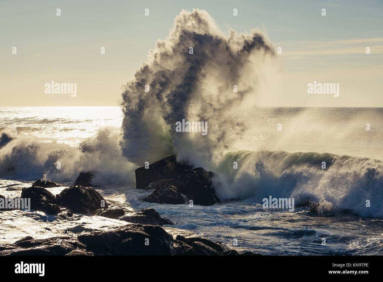 Big waves smashing on rocks of Atlantic Ocean shore in Nevogilde civil parish of Porto, second largest city in Portugal. - Stock Image