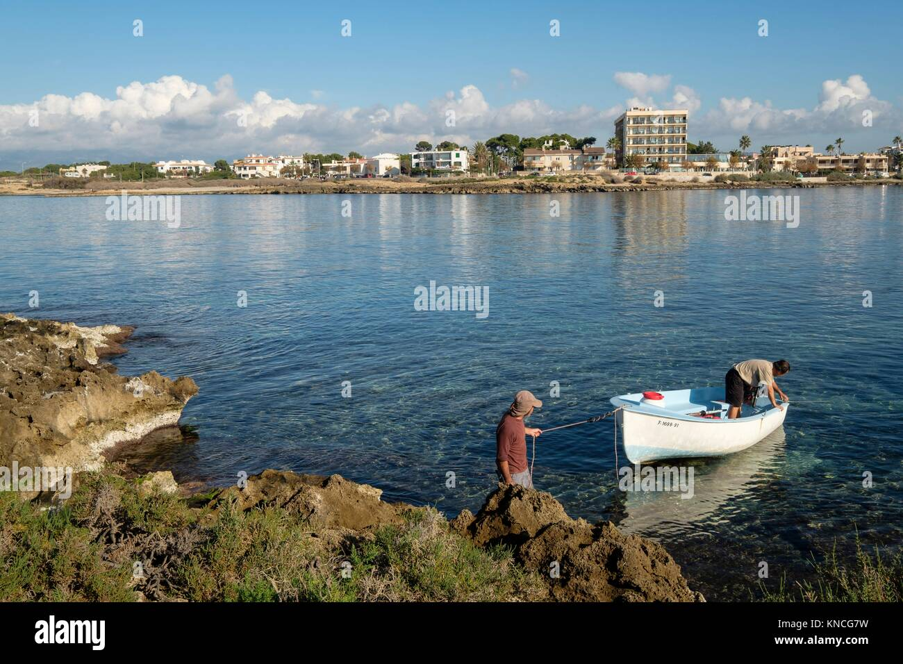 Boat arriving at Punic archaeological site in Na Galera islet, Can Pastilla, Palma, Mallorca, balearic islands, - Stock Image