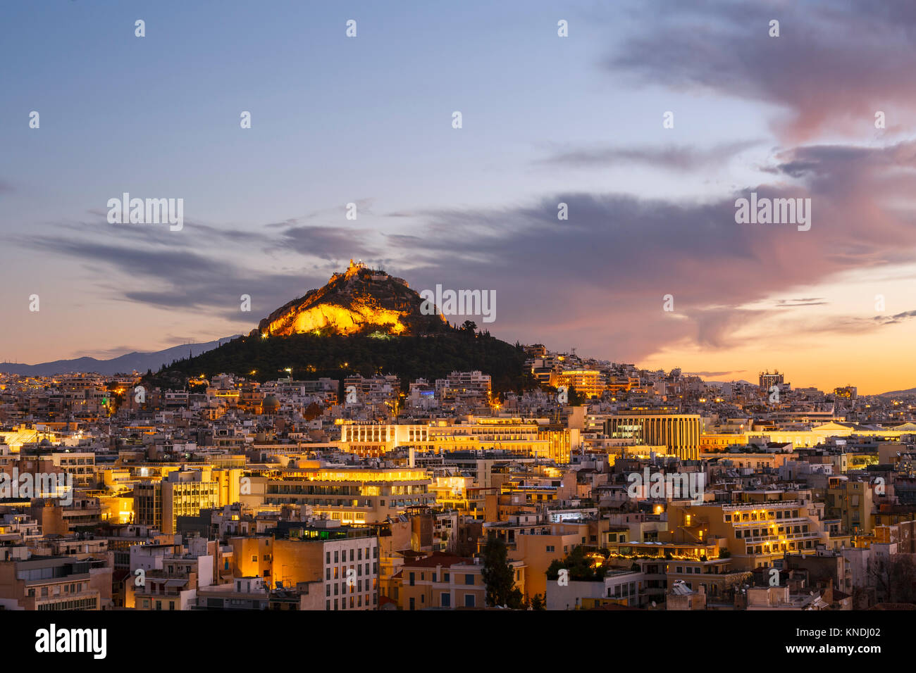 View of Lycabettus hill from Anafiotika neighborhood in the old town of Athens, Greece. - Stock Image