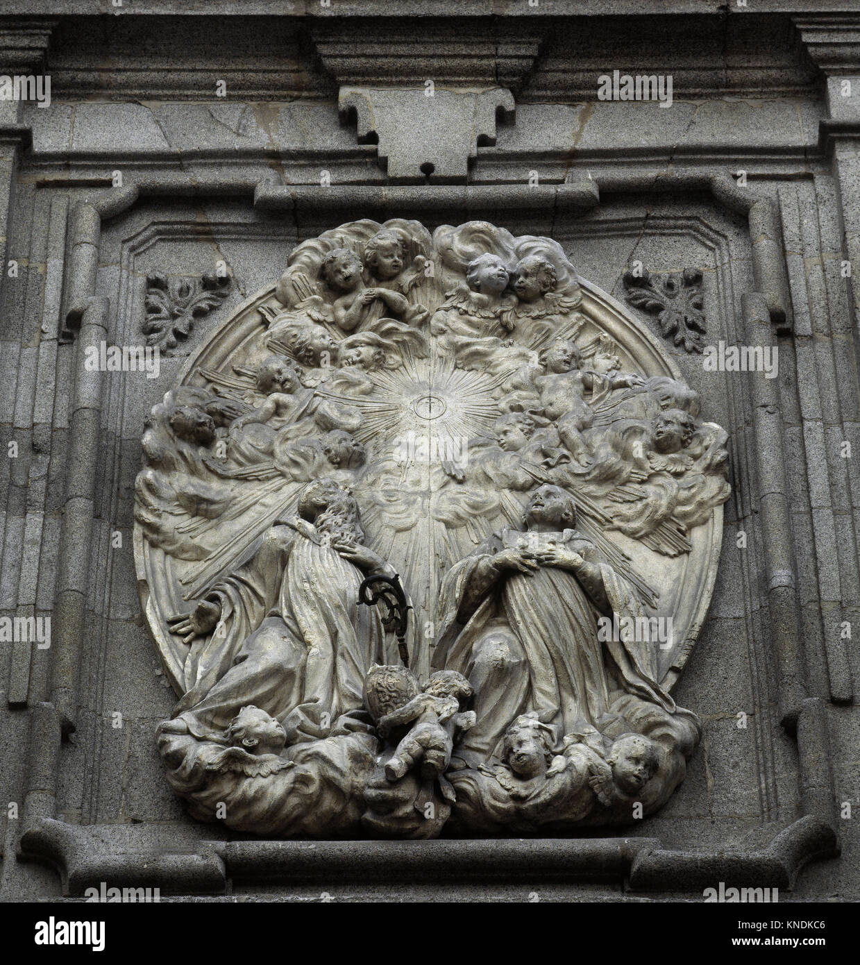 Saint Basil the Great (329-379) and Saint Benedict of Nursia (480-543) before the Eucharist. Relief. Facade of archiepiscopal - Stock Image