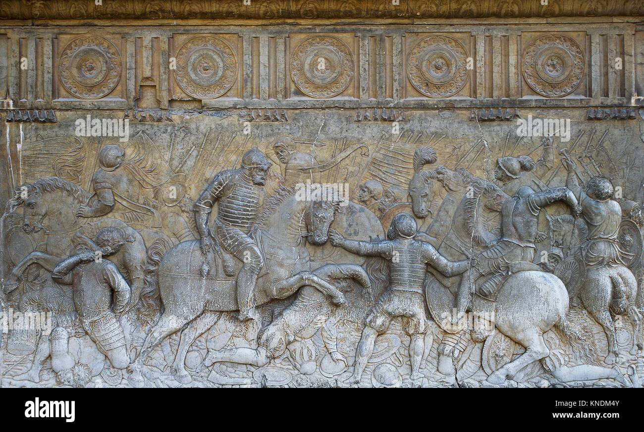 Emperor Charles V at the Battle of Pavia in 1525 (Italian War). Relief by Niccolo Da Corte, 1547. Facade of Palace - Stock Image