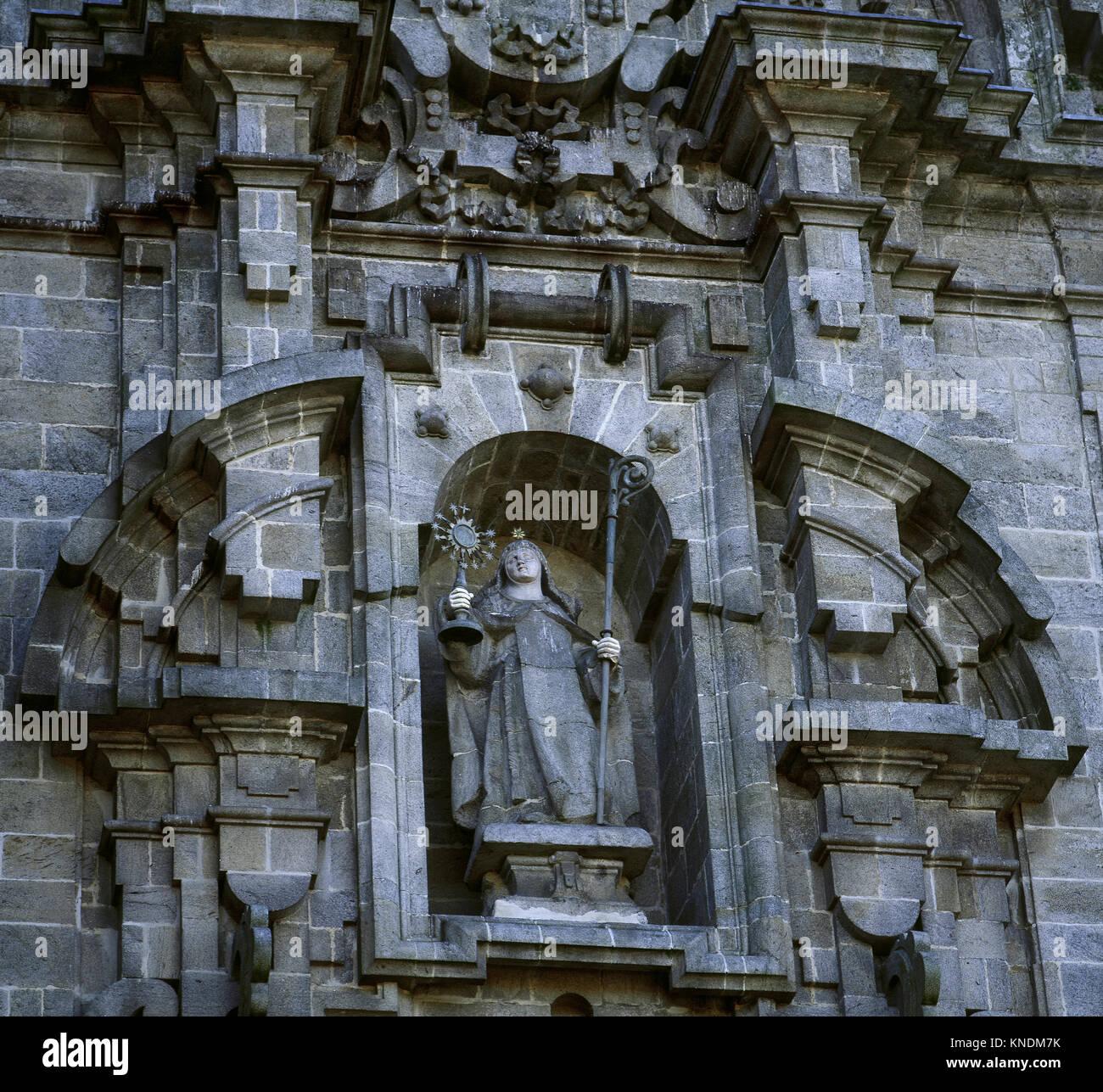 Statue of Clare of Assisi (1194-1253). Italian saint. Baroque facade of da Igrexa, by Simon Rodriguez, 1719. Convent - Stock Image