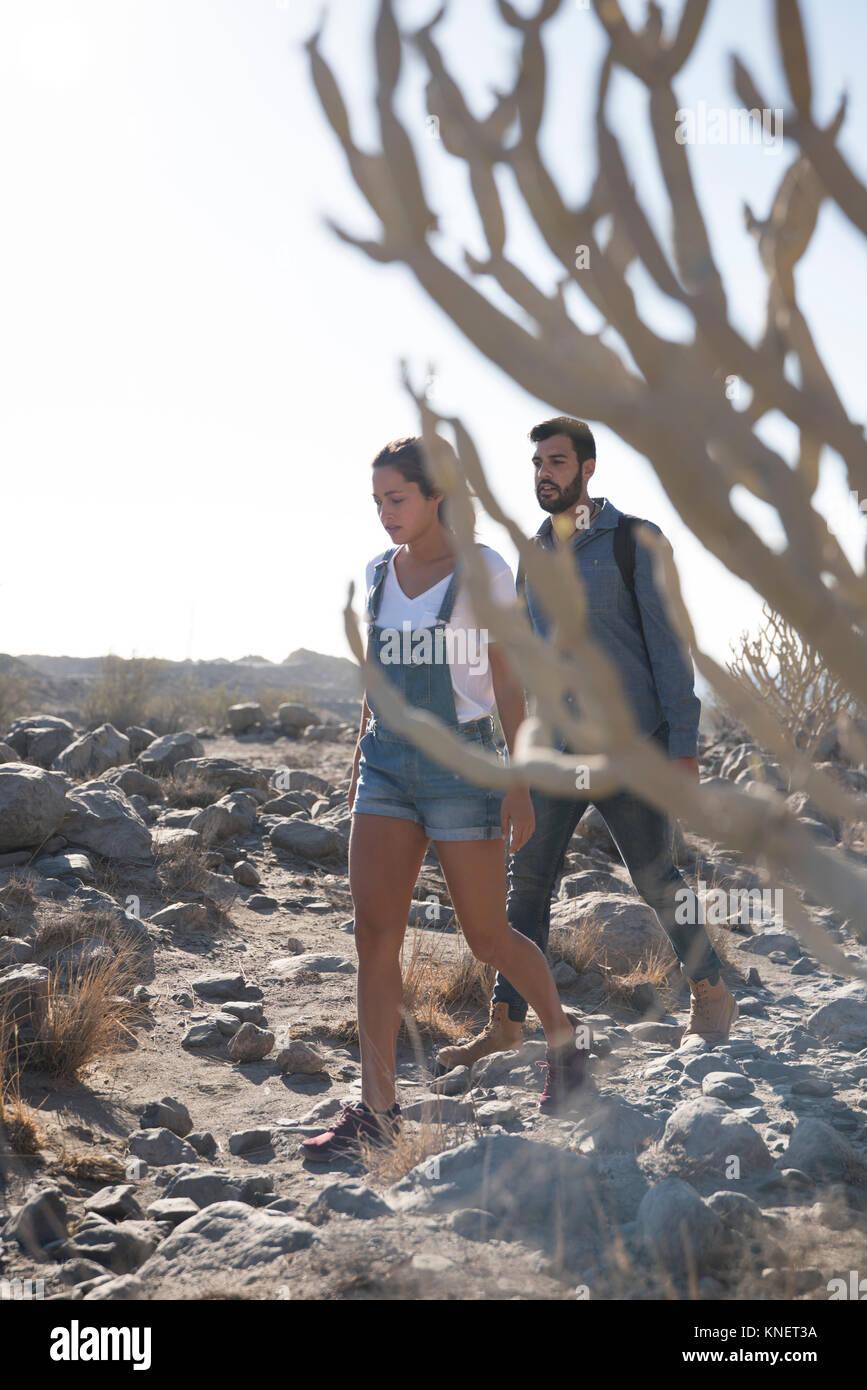 Young hiking couple hiking over rocks, Las Palmas, Canary Islands, Spain - Stock Image