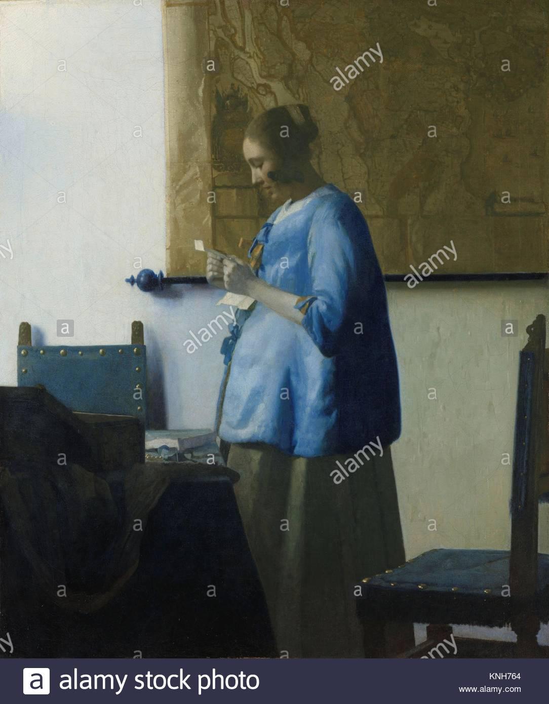 Woman Reading a Letter Johannes Vermeer, c. 1663, Rijksmuseum, Netherlands, - Stock Image