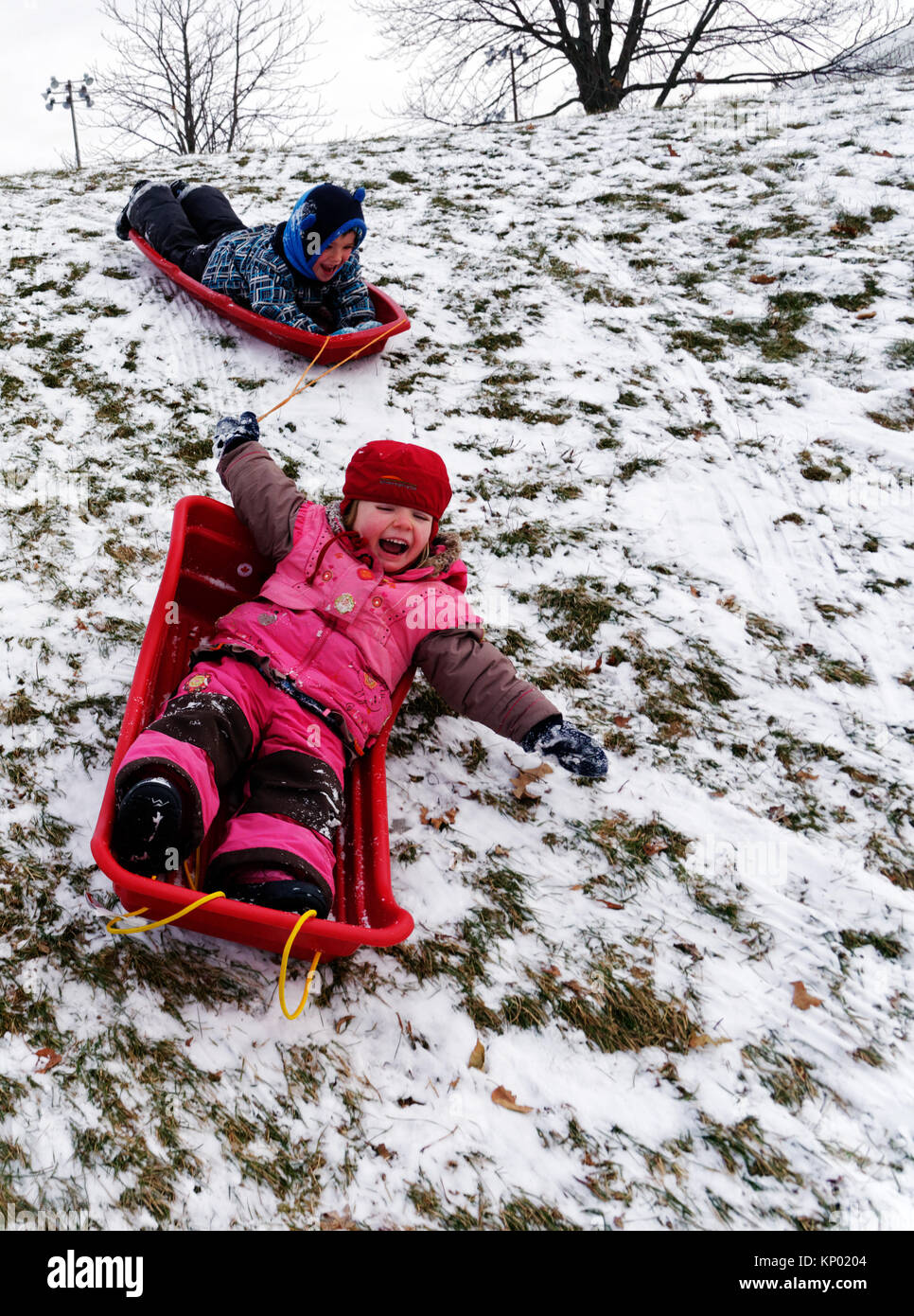 brother-and-sister-5-and-3-yrs-old-sledging-together-in-quebec-city-KP0204.jpg