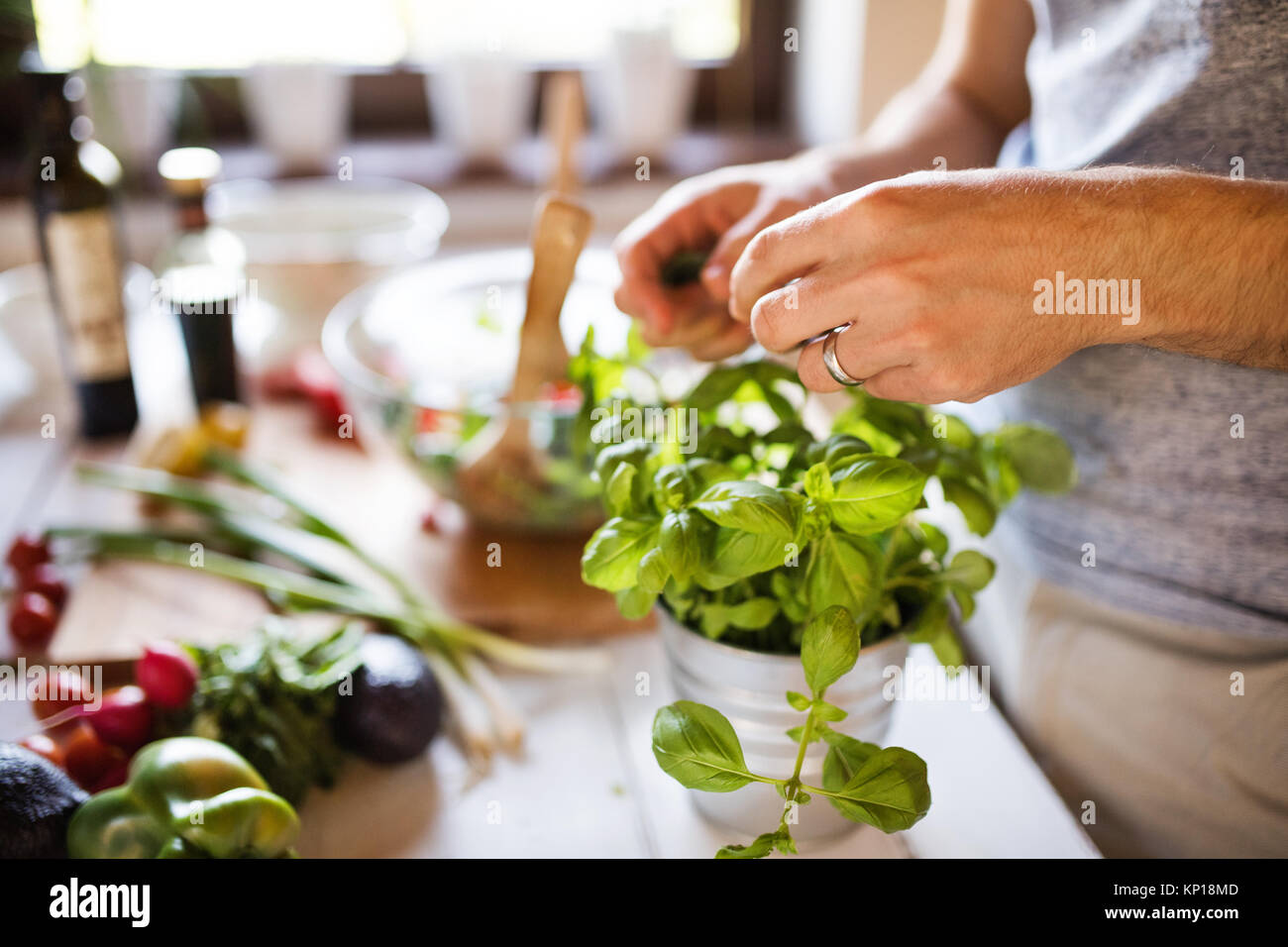 Unrecognizable young man cooking. - Stock Image
