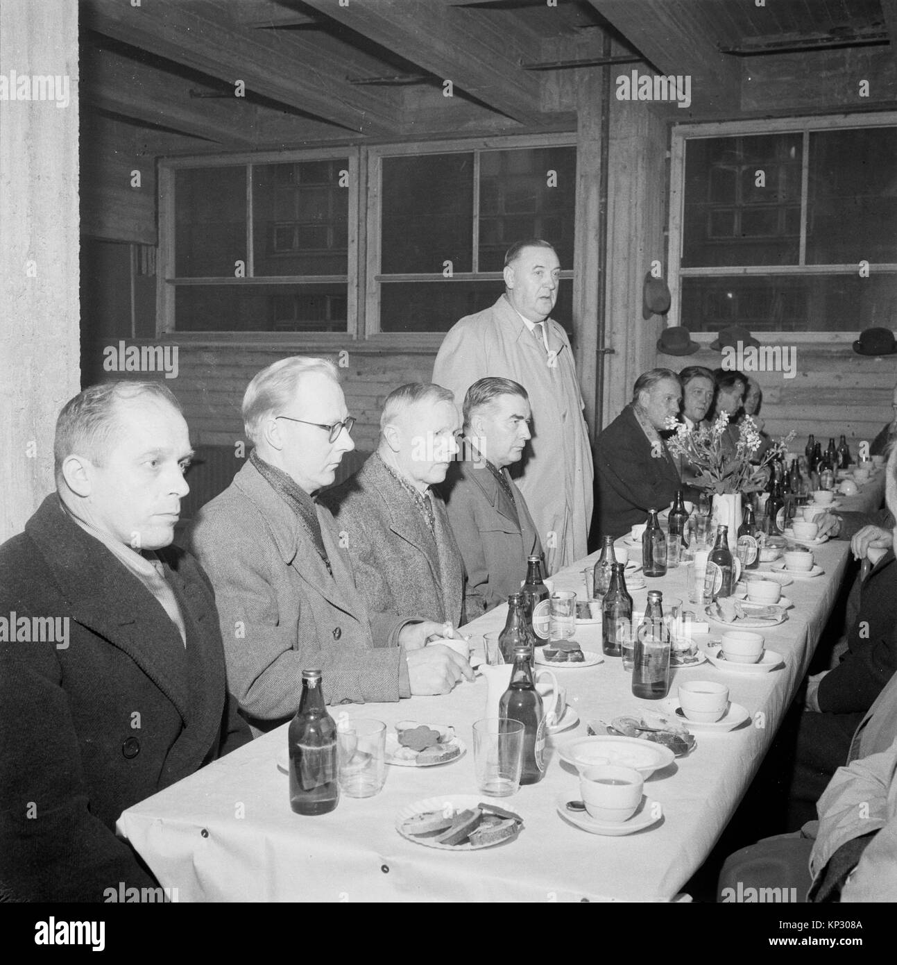 Small party in industrial setting for completion ceremony of new printing press, Helsinki, Finland, 1956 - Stock Image