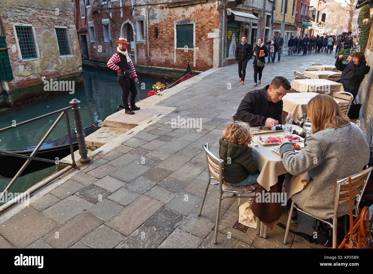 Gondolier waiting for clients at lunch time in Venice, Italy - Stock Image