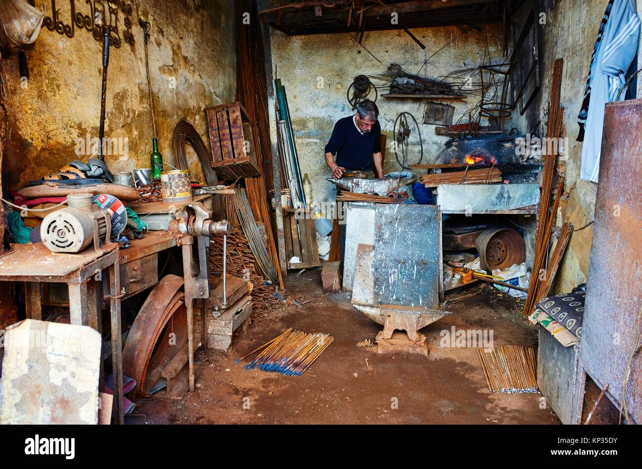 A blacksmith in the medina of Meknes, Morocco - Stock Image