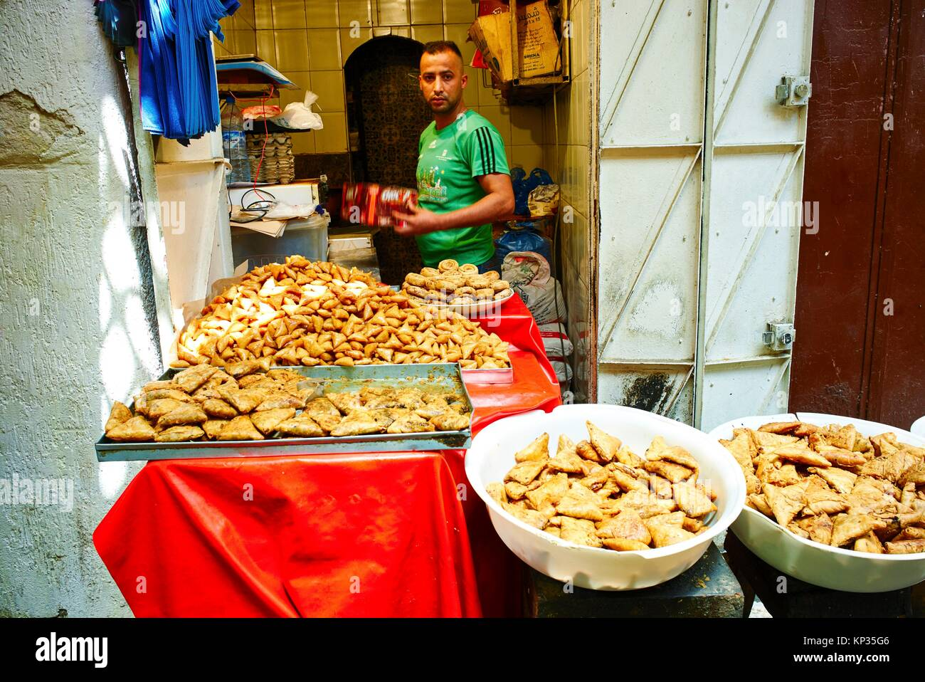 Selling traditional moroccan fried sweets in Fez, Morocco - Stock Image