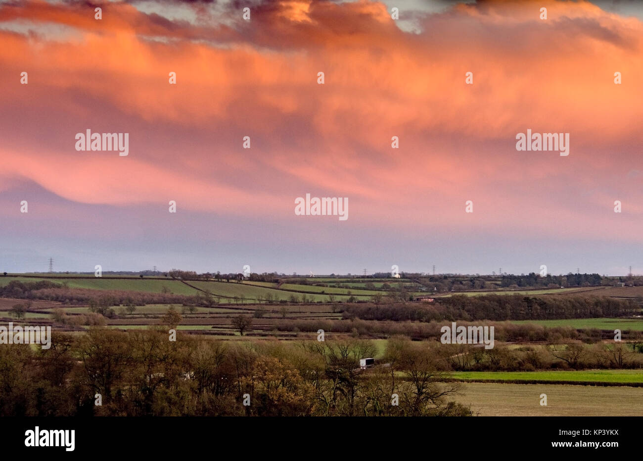 Melton Mowbray, UK. 13th December, 2017. Red sky full of drama after a cold day. Credit: Clifford Norton/Alamy Live - Stock Image