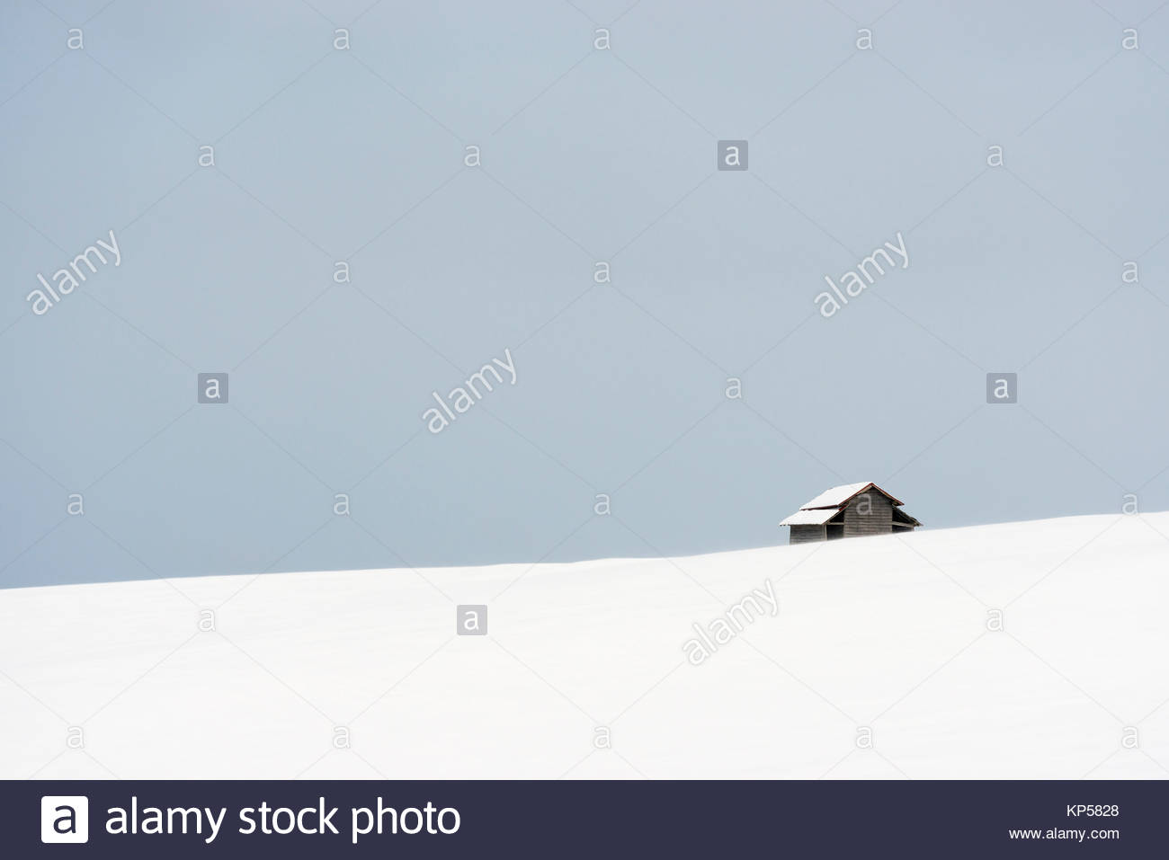 House on a snow covered hill.  Minimalist winter scene in Biei, Hokkaido, Japan - Stock Image