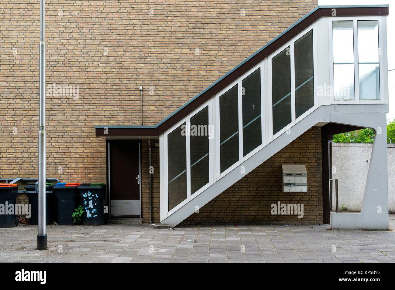 Tilburg, Netherlands. Elevating stairs towards the second floor of an 1960´s designed apartment building. - Stock Image