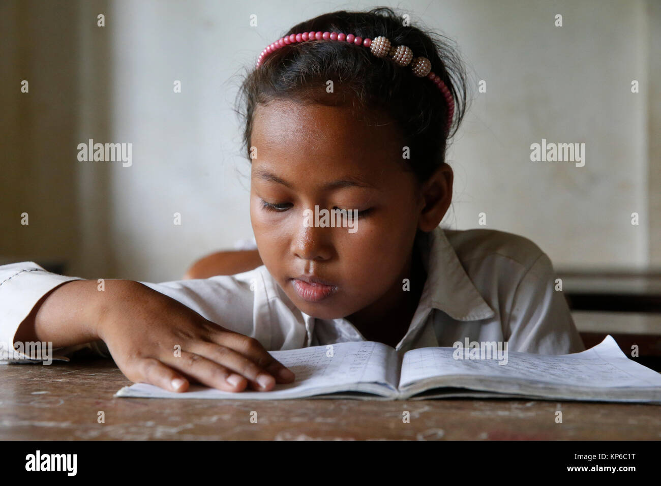 Cambodian schoolgirl in classroom. Battambang. Cambodia. - Stock Image