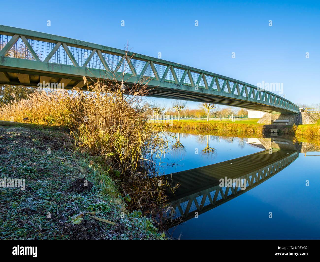 Public footbridge across river Claise, Preuilly-sur-Claise, France. - Stock Image