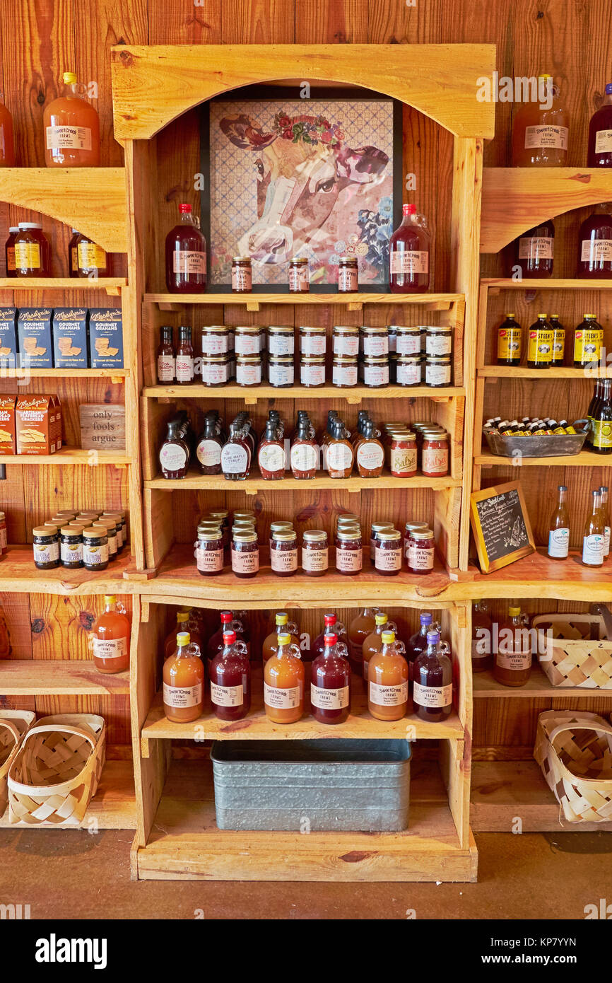 Country store shelves with homemade jam,cider, jelly and honey in a nice display in a rural farm store in rural - Stock Image