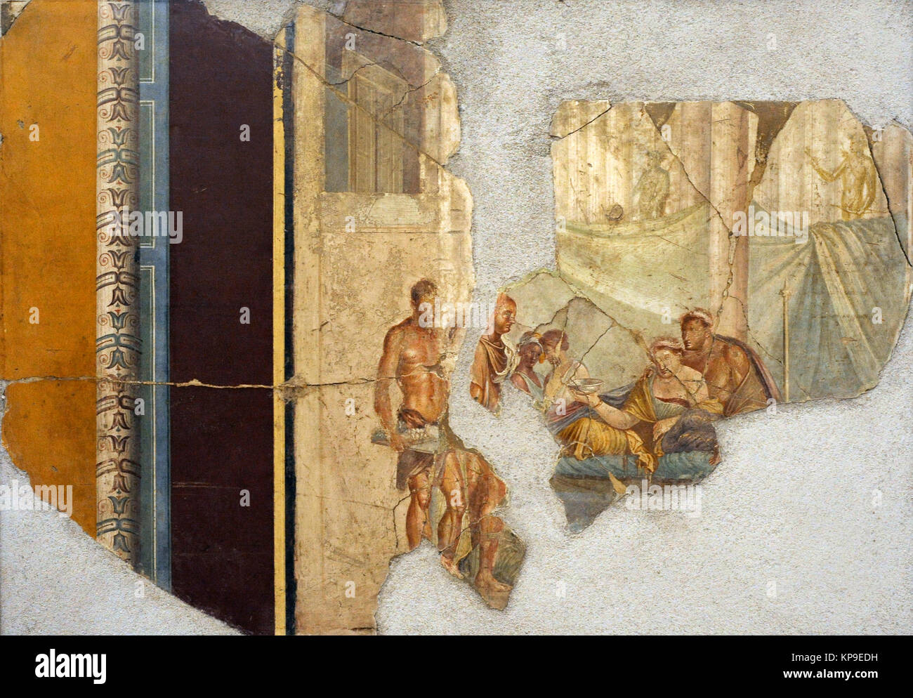 Roman fresco depicting, on the left, parts of an edicle decorated with chiselled motifs. Inside, a banquet scene. - Stock Image