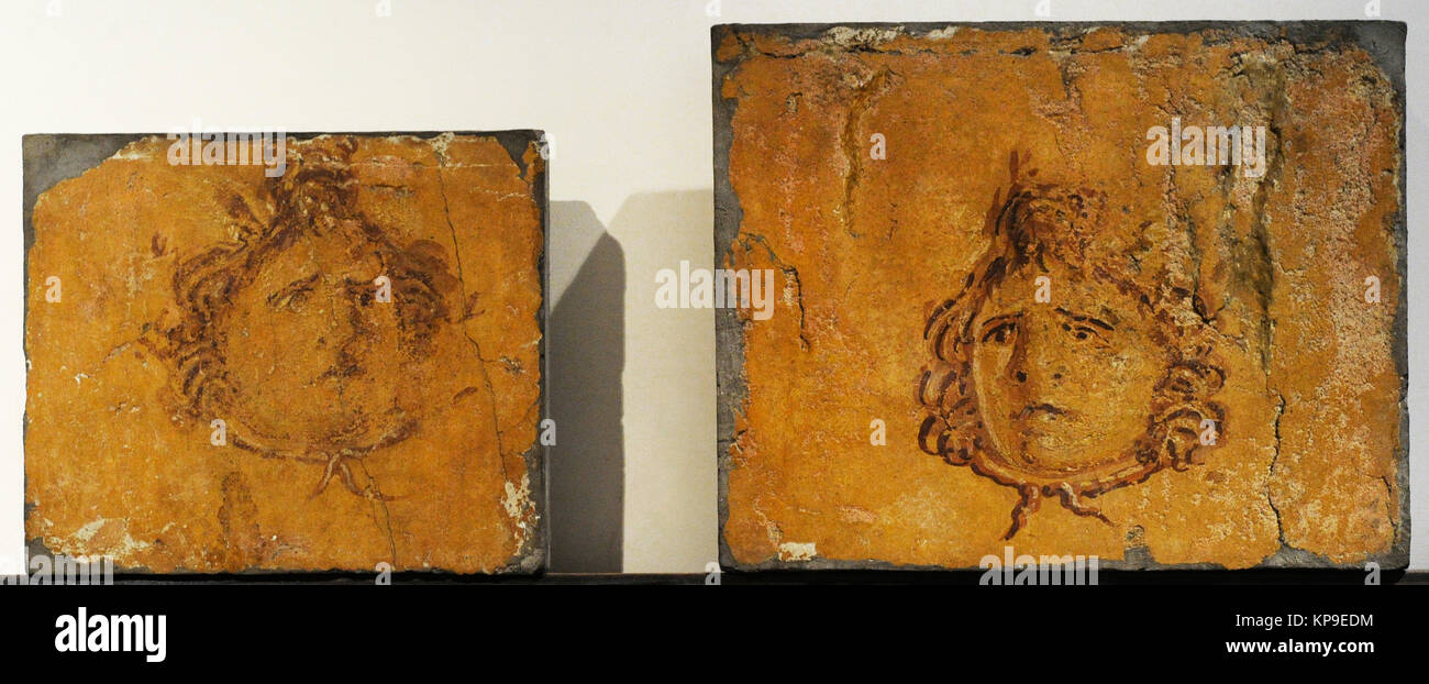 Roman fresco depicting two masks. Villa of the Papyri. Herculaneum. National Archaeological Museum. Naples. Italy. - Stock Image