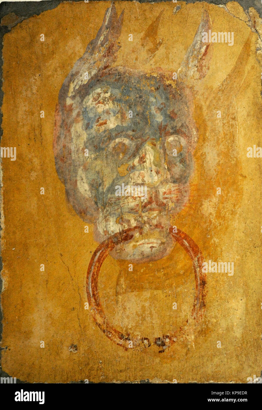 Roman fresco depicting a door frame with a monstrous head. Villa of the Papyri. Herculaneum. National Archaeological - Stock Image