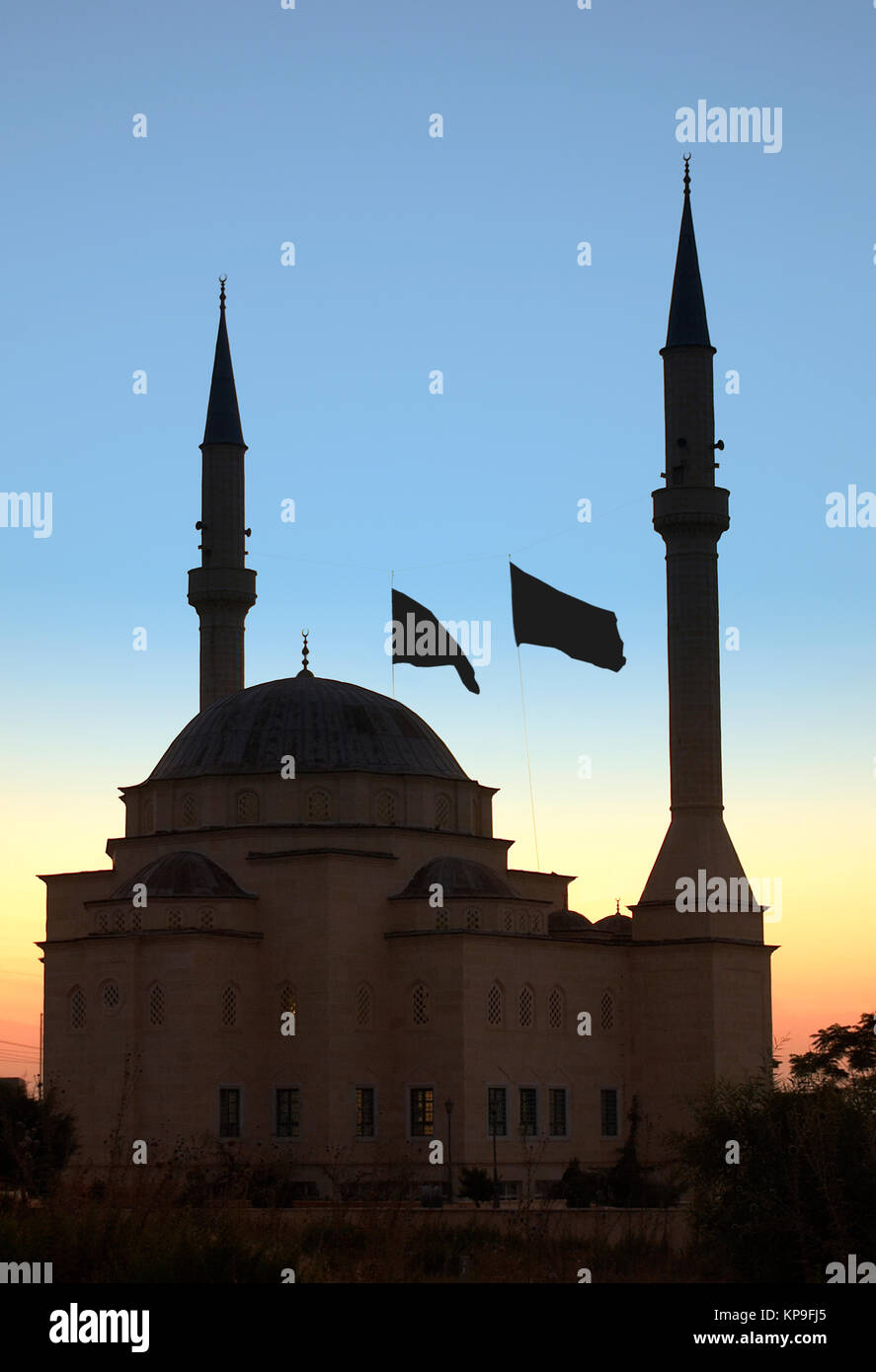 A Mosque at dawn in the town of Kyrenia (Girne) in the Turkish Republic of Northern Cyprus. - Stock Image