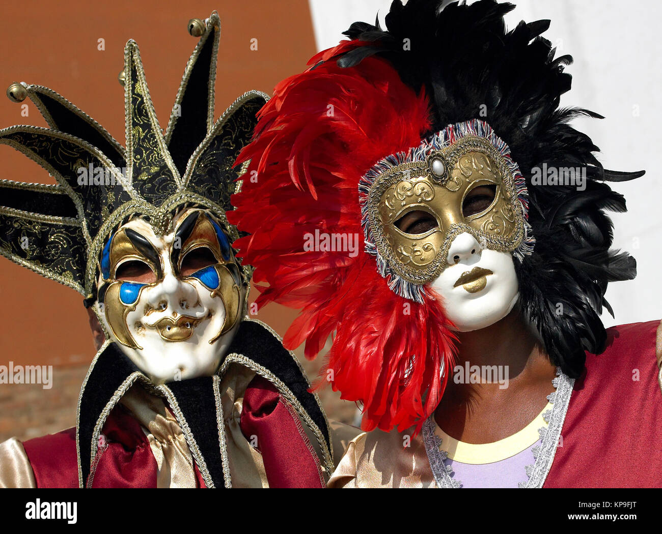 Masked figures at the Venice Carnival in the city of Venice in northern Italy. - Stock Image
