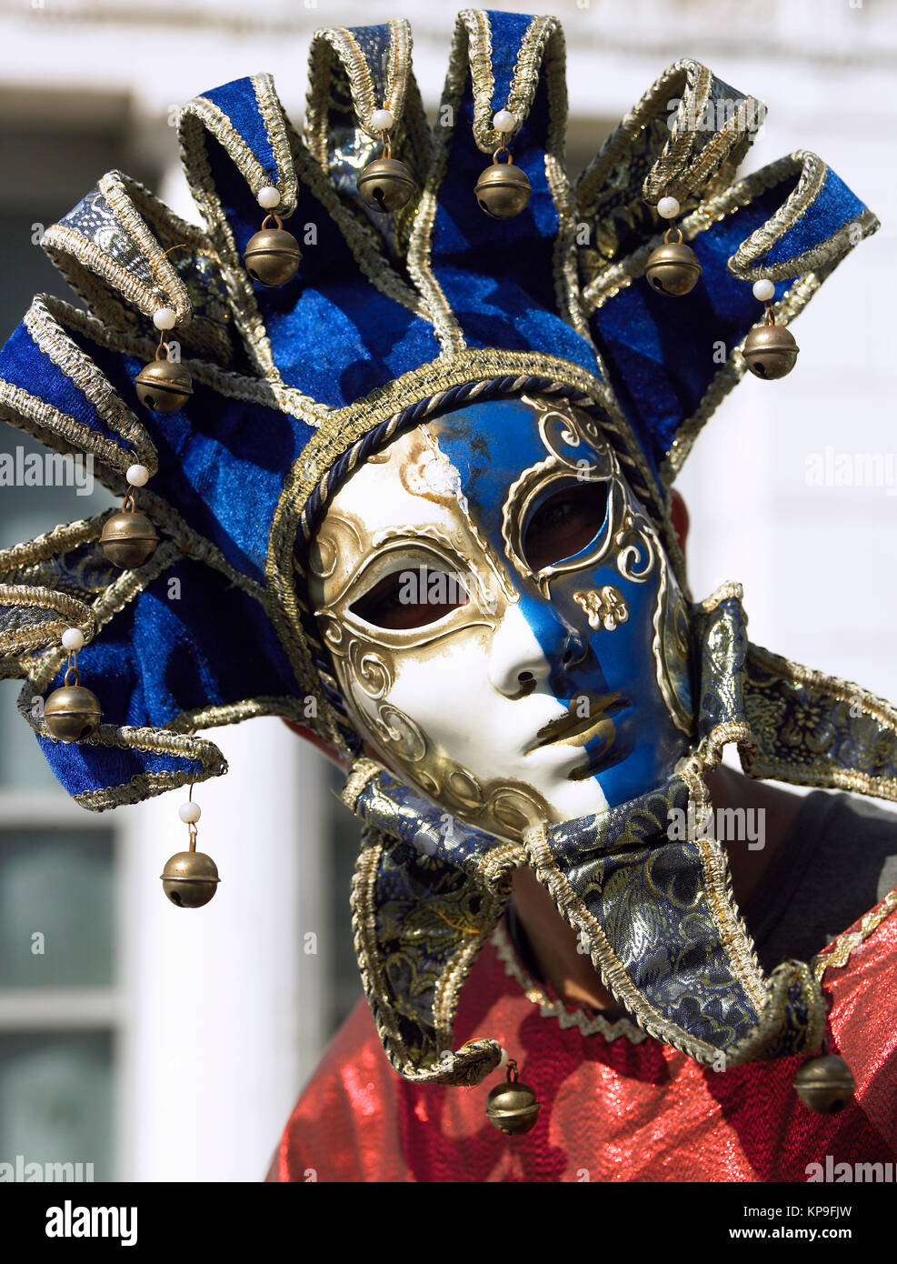 Masked figure at the Venice Carnival in the city of Venice in northern Italy. - Stock Image