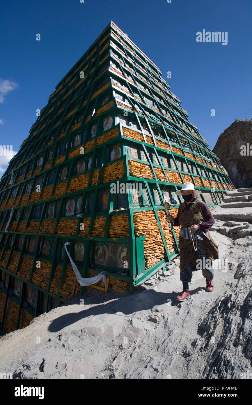 A Buddhist shrine in the city of Lhasa in the Tibet Autonomous Region of China. The unfinished pyramid is made from - Stock Image