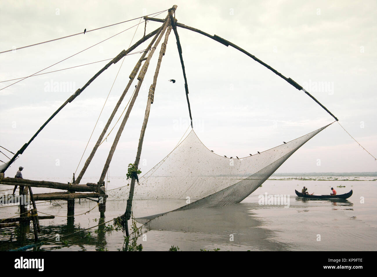 Chinese Fishing nets at Kochi in the Kerala region of southern India. Chinese fishing nets are fixed land installations - Stock Image