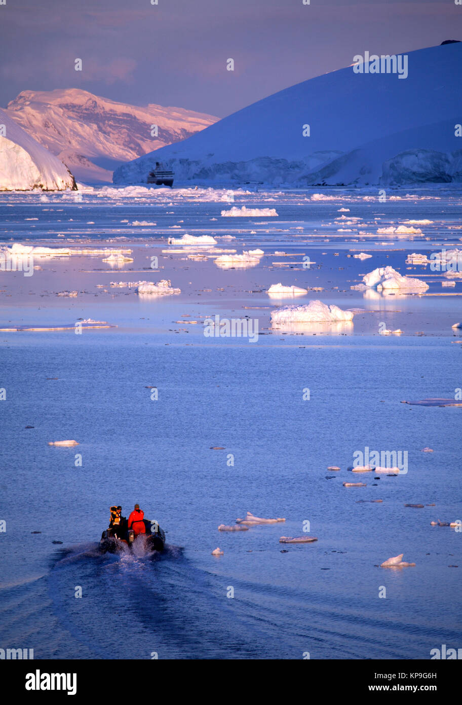 Tourist ship and zodiac in the Lamaire Channal on the Antarctic Peninsula in Antarctica. - Stock Image