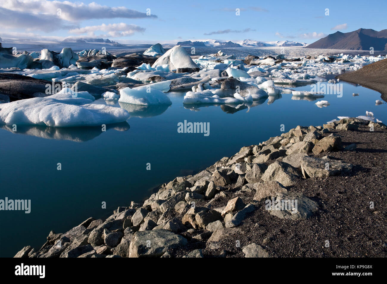 Icebergs slowly melting in Jokulsarlon glacier lagoon on the south coast of Iceland. - Stock Image