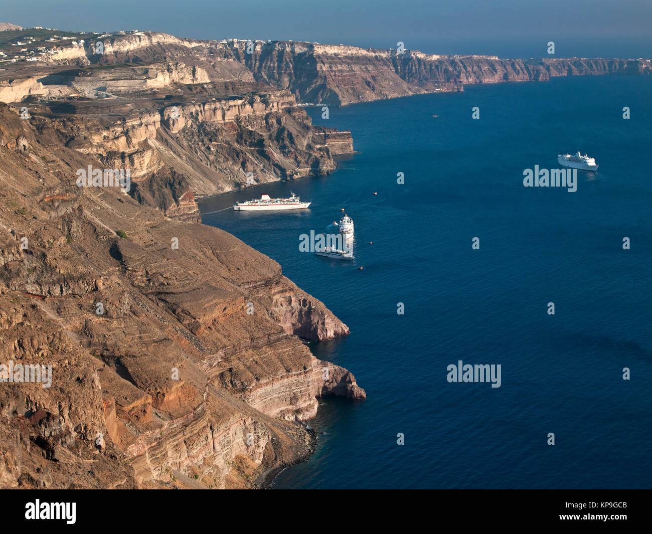Cruise ships at the Greek volcanic island of Santorini in the Aegean Sea off the coast of mainland Greece - Stock Image