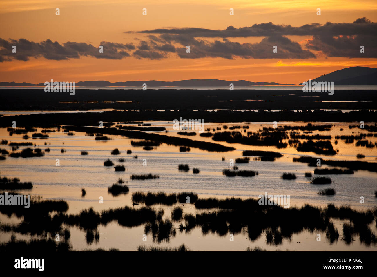 Sunset over Lake Titicaca in southern Peru. The lake is on the border between Peru and Bolivia. At an altitude of - Stock Image