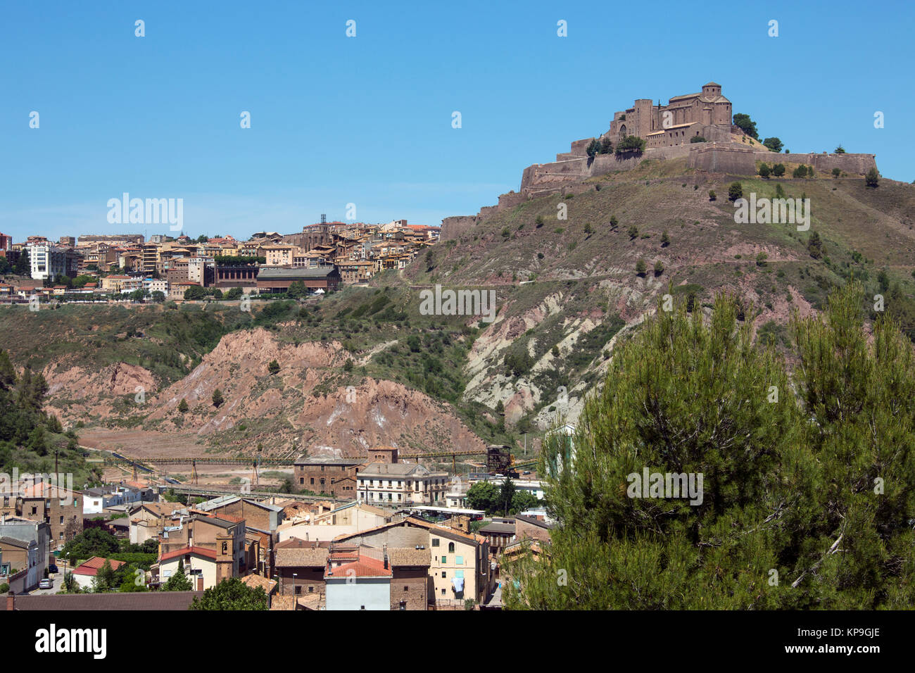 Cardona Castle and Abbey high above the industrial town of Cardona in the Catalonia region of Spain. - Stock Image