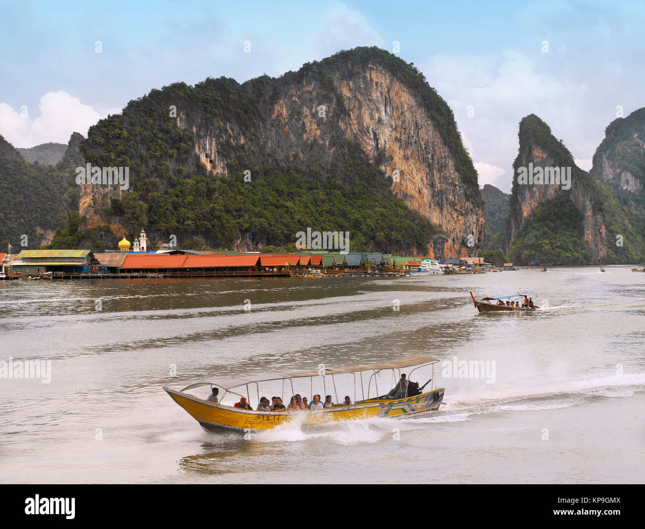 Long-tailed boats near Panyi floating Muslim village in Phangnga Bay near Phuket in southern Thailand. - Stock Image