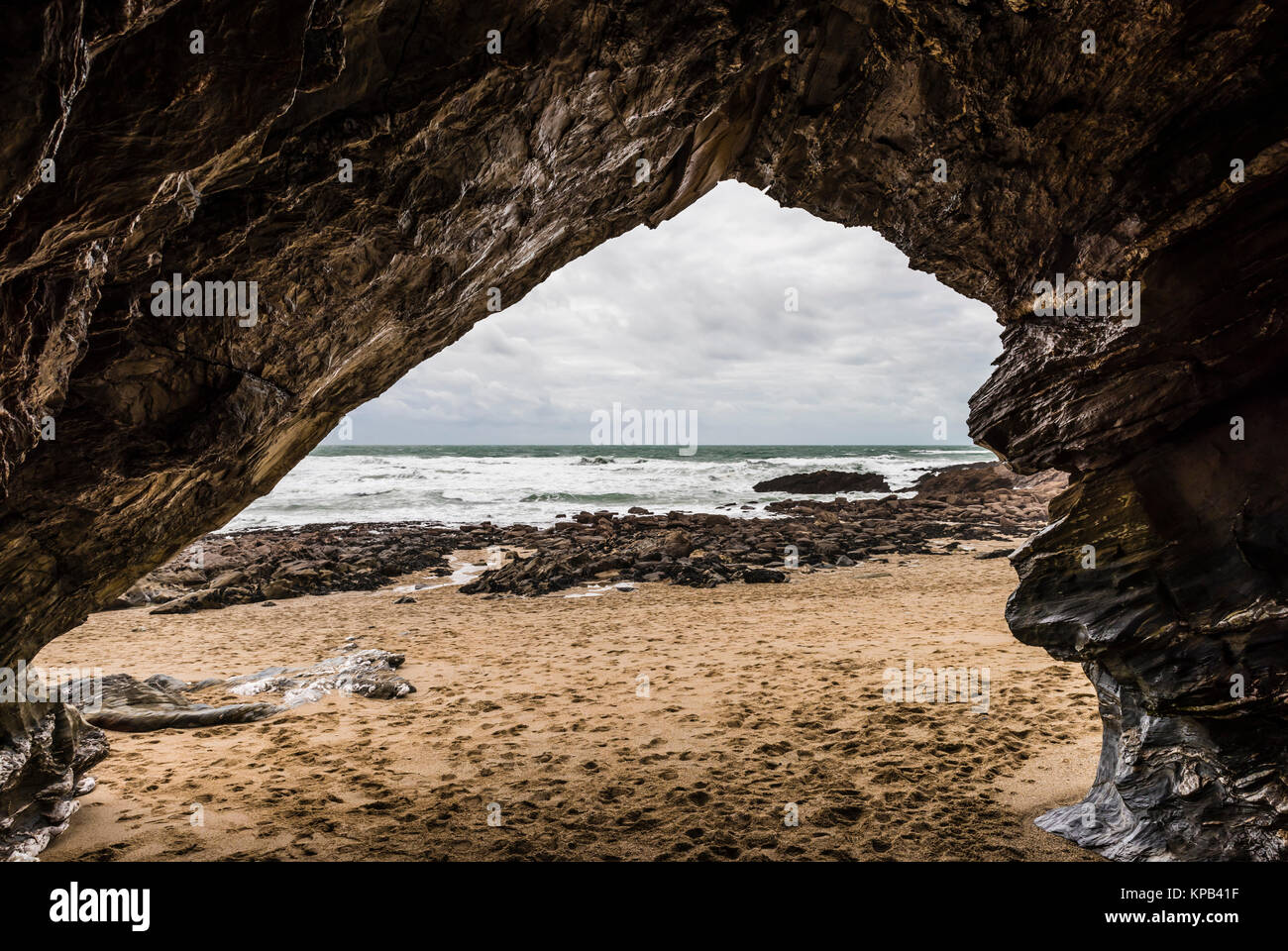 Looking through rocks at Fistral Beach, Cornwall, UK - Stock Image