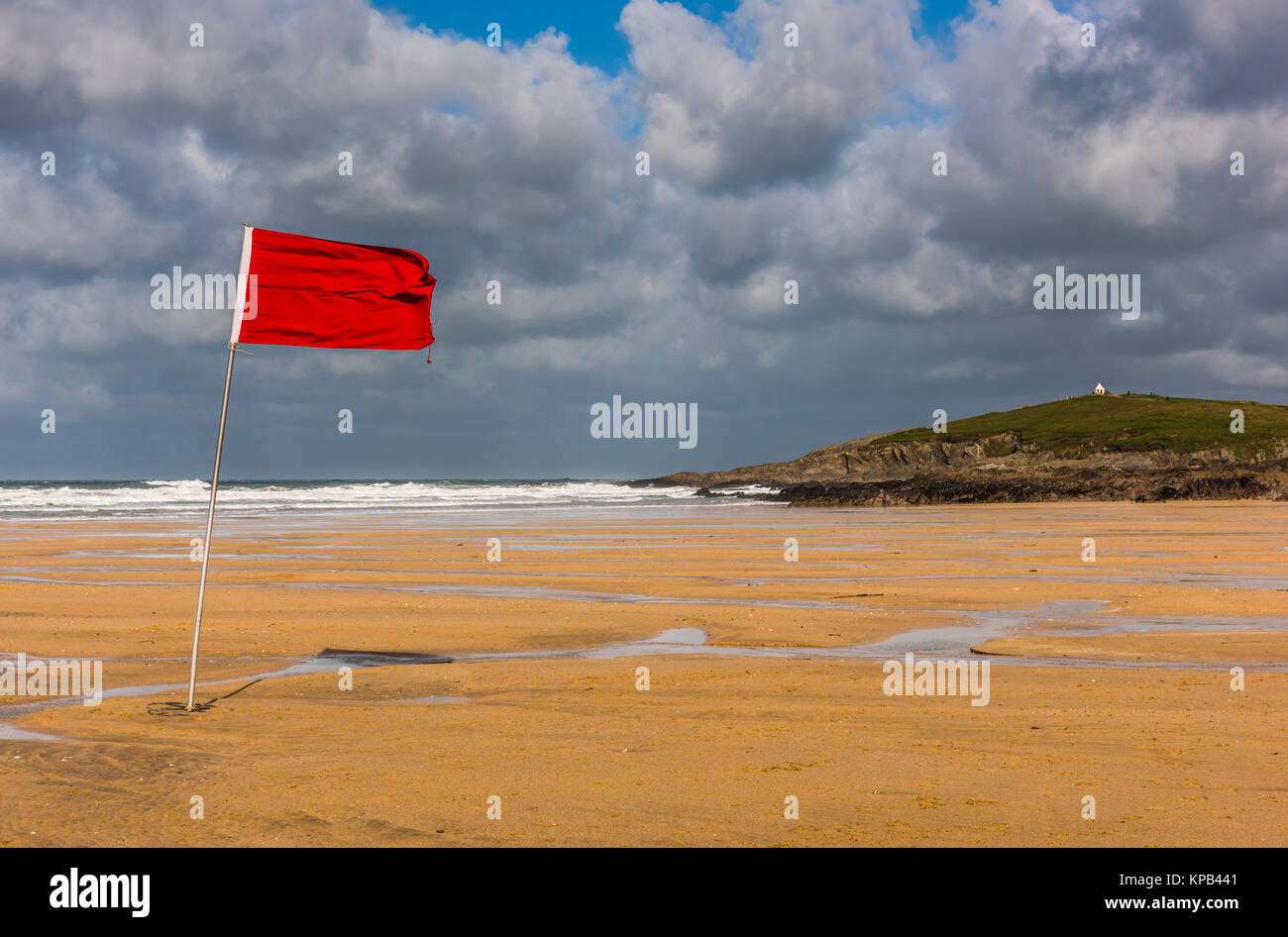 Red flag during Atlantic Storm Brian on Fistral Beach, Cornwall, UK - Stock Image