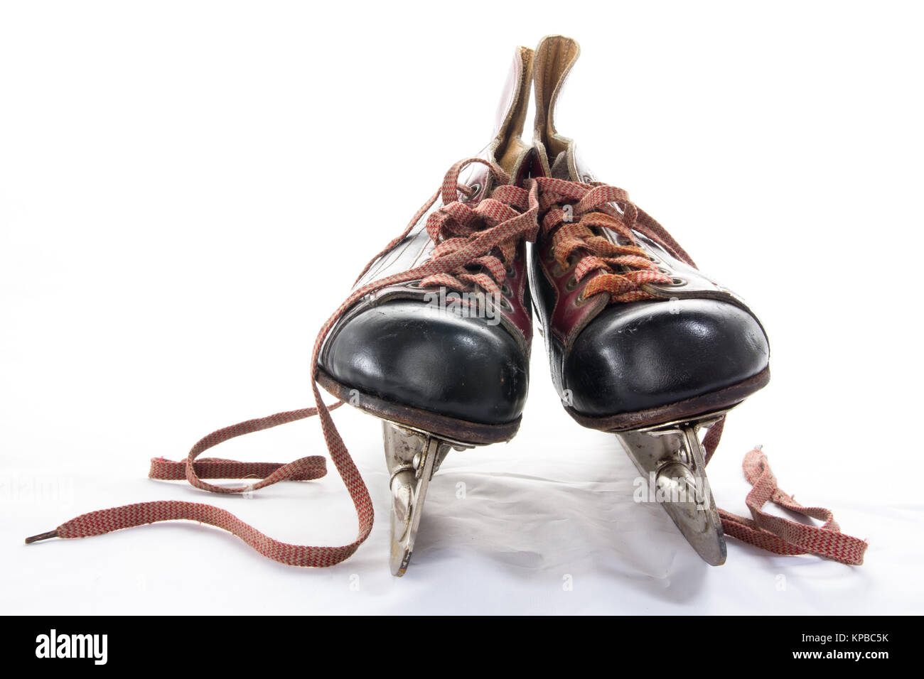 Two very old ice hockey skates on white background - Stock Image