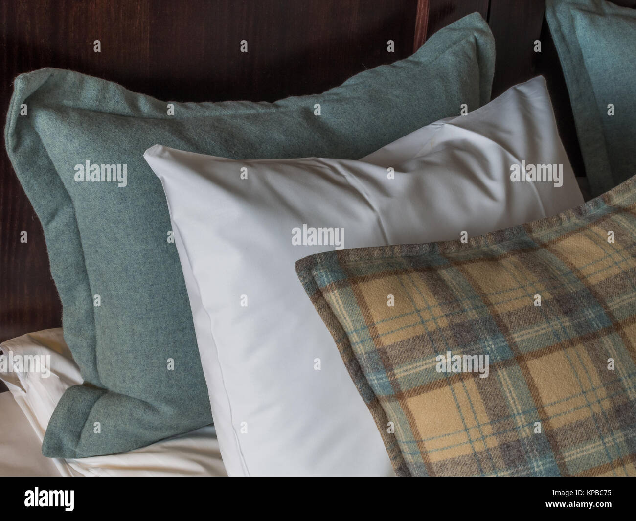 Pillows arranged on a hotel bed - Stock Image