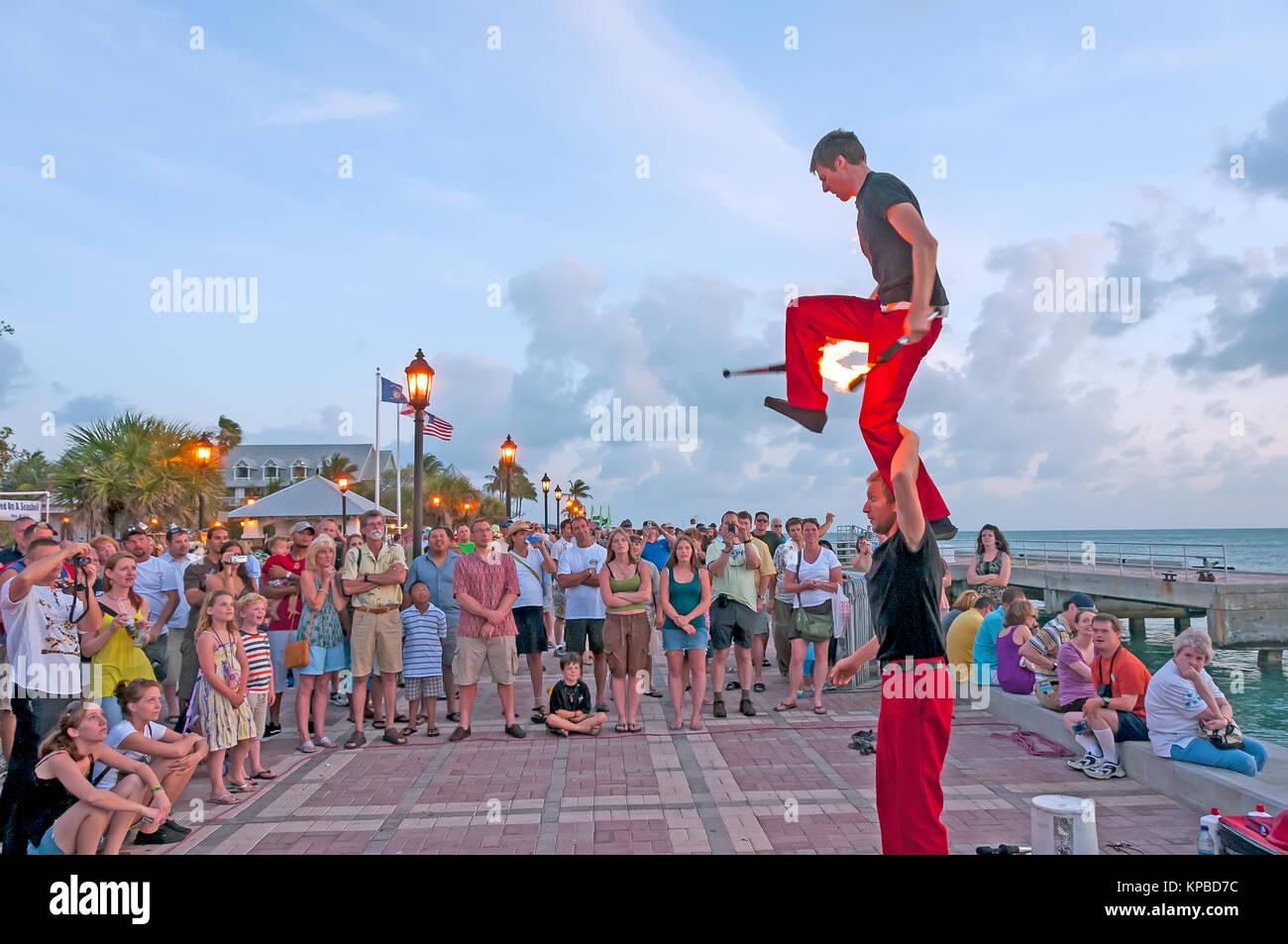 Acrobatic jugglers with fire batons Sunset Celebration Key West Florida - Stock Image