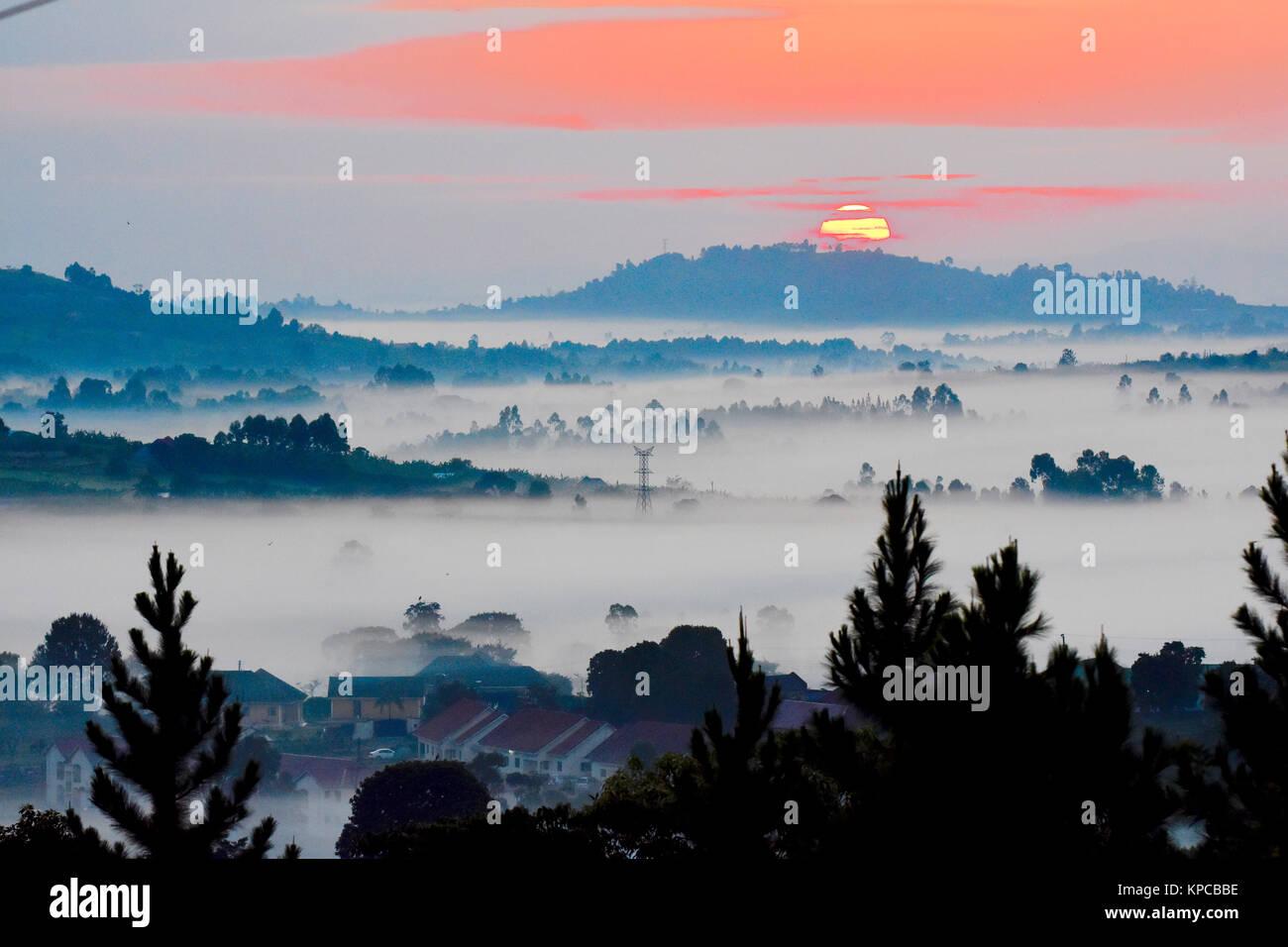 Sunrise over misty valles of western Uganda. - Stock Image