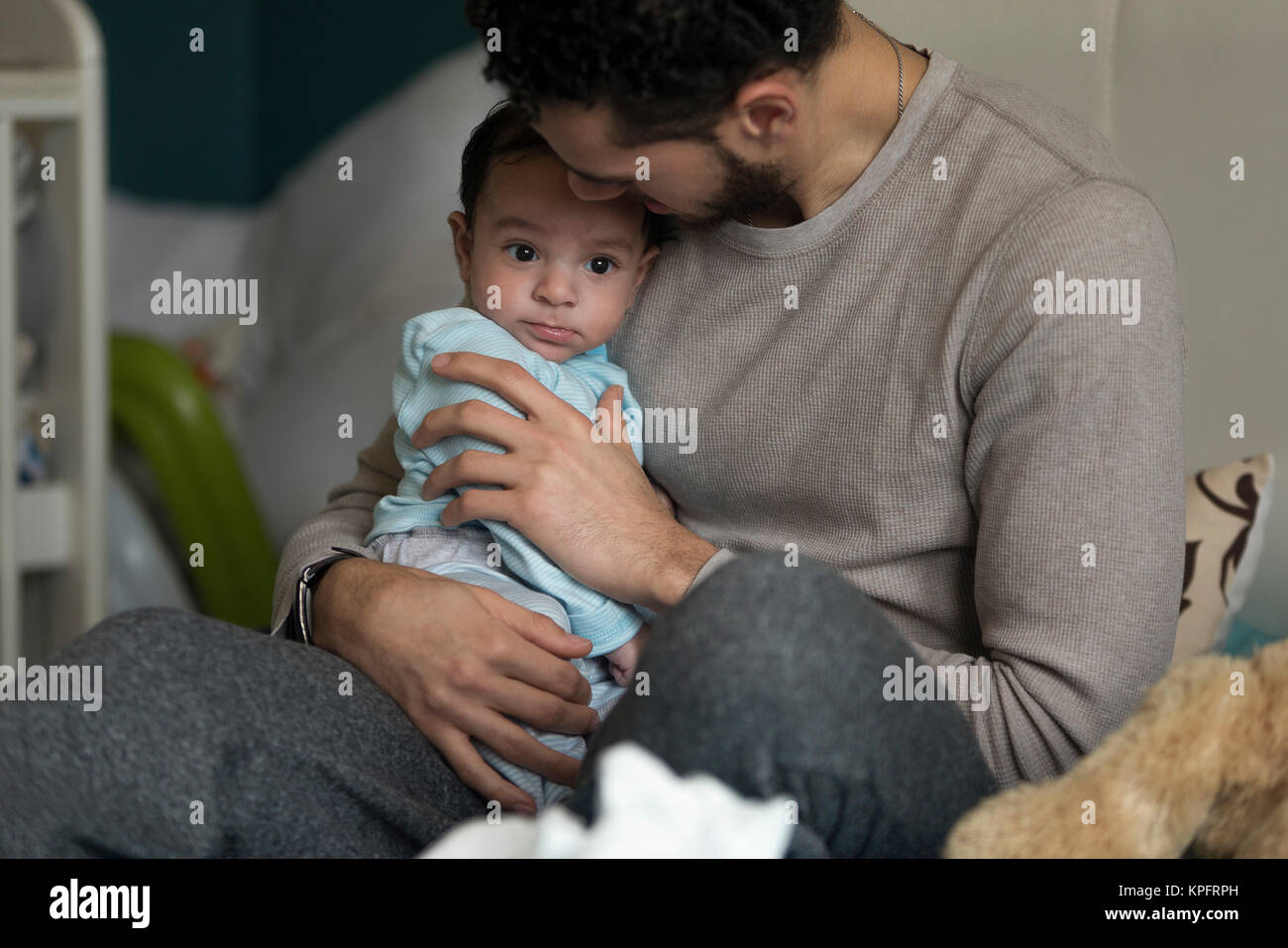 Cuddles with daddy - Stock Image