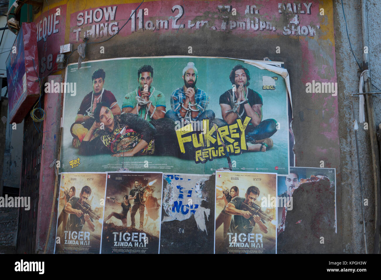 Rustic movie theatre with Bollywood movie posters showing current movies in Shimla, India - Stock Image