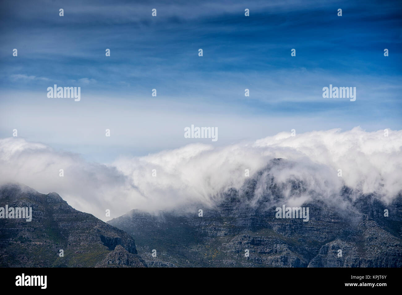 Clouds rolling over the top of Table Mountain in Cape Town, South Africa - Stock Image