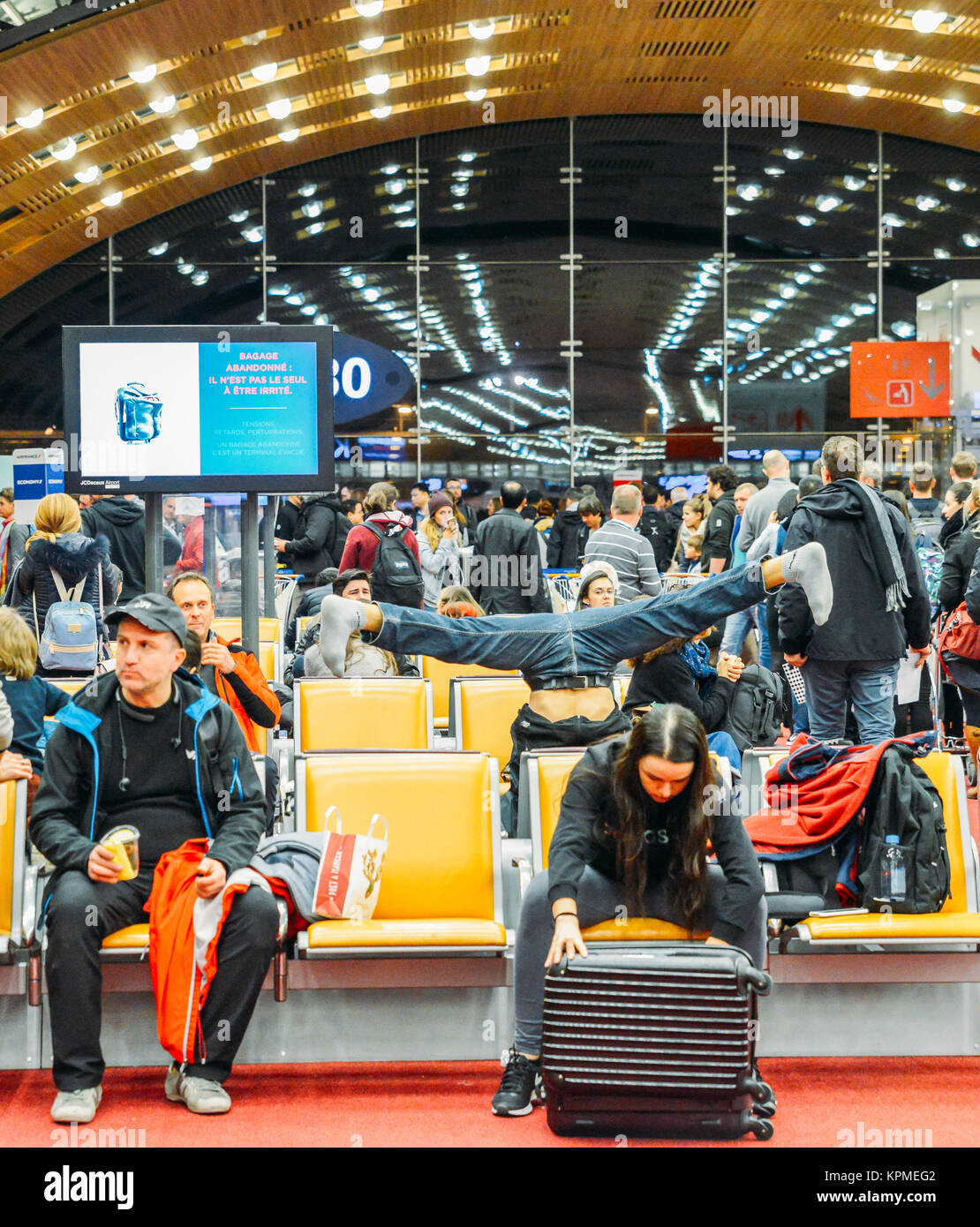 paris-france-december-12th-2017-man-performs-a-splits-prior-to-boarding-KPMEG2.jpg