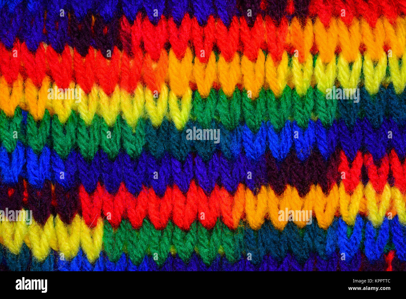 Bold bright primary colorful knitting stitch background. - Stock Image